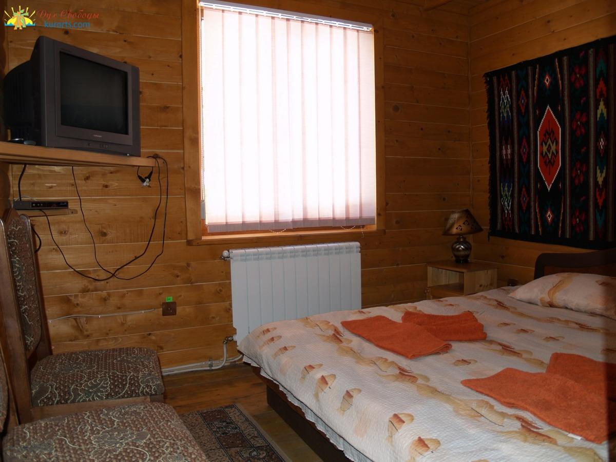 Спальня номер люкс в коттедже